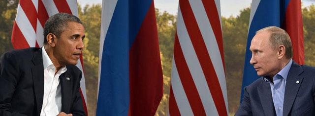 Obama con Putin durante el G8.| Afp