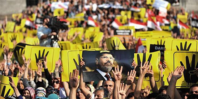 Manifestación en El Cairo de los simpatizantes de Mursi. | Foto: Afp