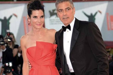 Sandra Bullock y George Clooney, en el estreno de su película en Venecia. | Efe