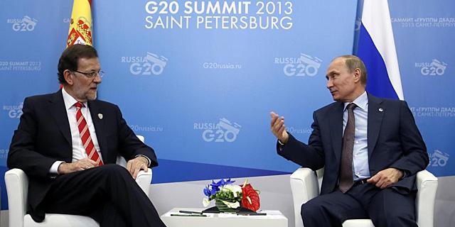 Mariano Rajoy y Vladimir Putin, durante su encuentro en San Petersburgo. | Reuters
