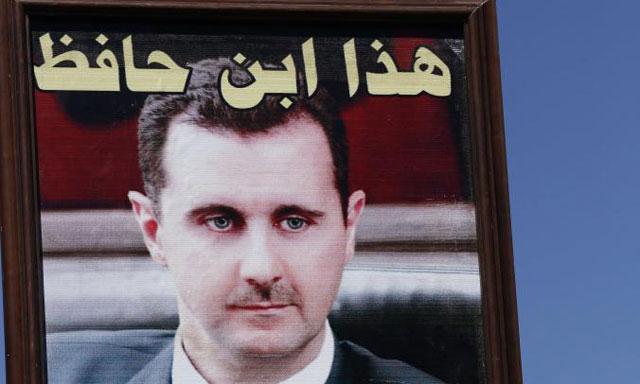 Un cuadro con la foto de Bashar al Asad.| Afp
