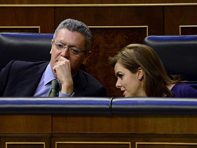 Ruiz-Gallardón y Sáenz de Santamaría, en el Congreso de los Diputados. | Bernardo Díaz
