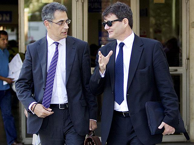 Los abogados de Jamal Zougam, Eduardo García Peña y Francisco Andujar, al salir de los juzgados de Plaza Castilla esta mañana. | Carlos García Pozo