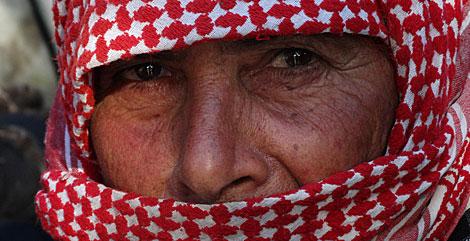 Una anciana refugiada siria que hubiera preferido morir en su tierra. | V. R.