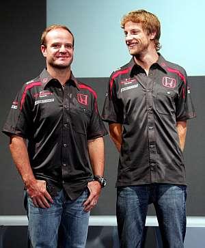 El brasileño Rubens Barrichello (izda), junto a Jenson Button. (Foto: AP)
