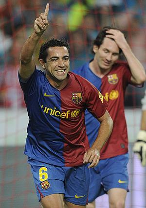 Xavi, celebrando su gol ante el Sporting. (FOTO: REUTERS)