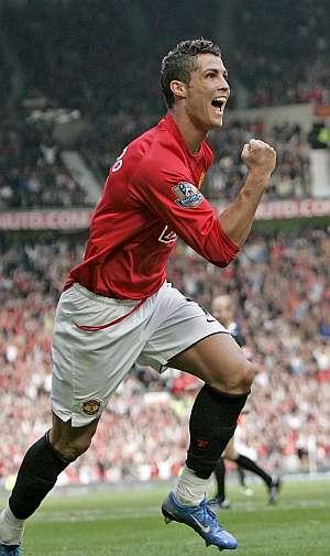 Cristiano celebra un gol ante el Wigan. (EFE)
