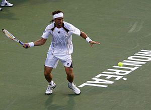 Ferrer devuelve una bola a Troicki. (Foto: EFE)