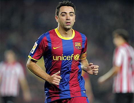 Xavi Hernández, en un partido con el Barcelona. (Foto: AFP)