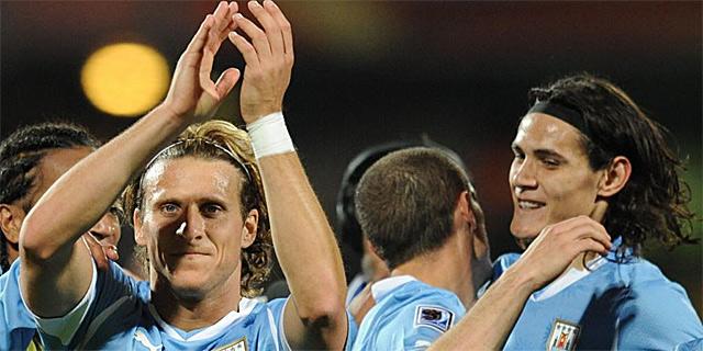 Los jugadores de Uruguay celebran su triunfo ante México. | AFP