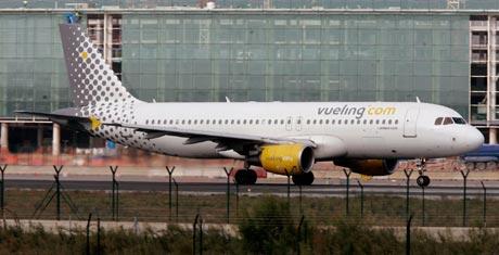 La empresa resultante mantendrá la marca de Vueling. (Foto: AFP)